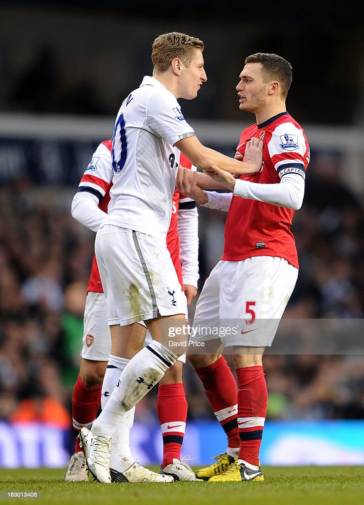 Thomas Vermaelen of Arsenal is pushed in the chest by Michael Dawson of Tottenham during the Barclays Premier League match between Tottenham Hotspur and Arsenal at White Hart Lane on March 3, 2013 in London, England.