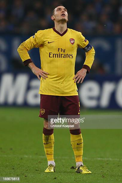 Thomas Vermaelen of Arsenal looks dejected after the 22 draw of the UEFA Champions League group B match between FC Schalke 04 and Arsenal FC at...