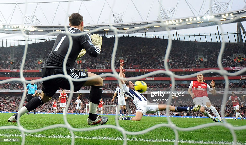 Thomas Vermaelen of Arsenal scores Arsenal's 2nd goal past Ben Foster of WBA during the Barclays Premier League match between Arsenal and West...