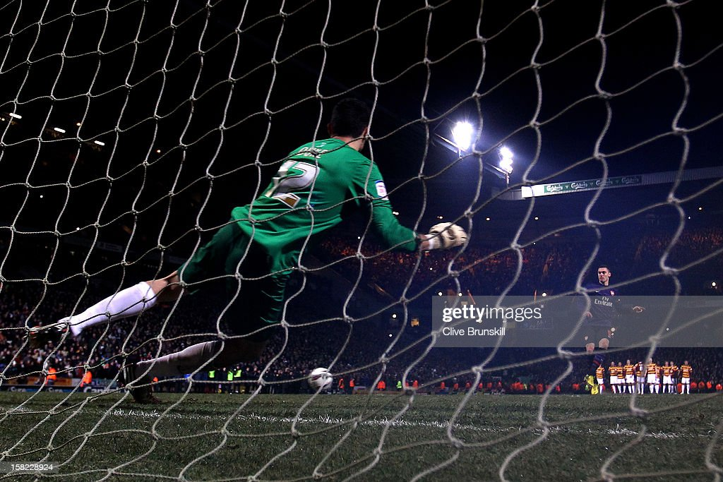 Thomas Vermaelen of Arsenal sees his penalty attempt hit the post to hand his team defeat during the Capital One Cup quarter final match between Bradford City and Arsenal at the Coral Windows Stadium, Valley Parade on December 11, 2012 in Bradford, England.