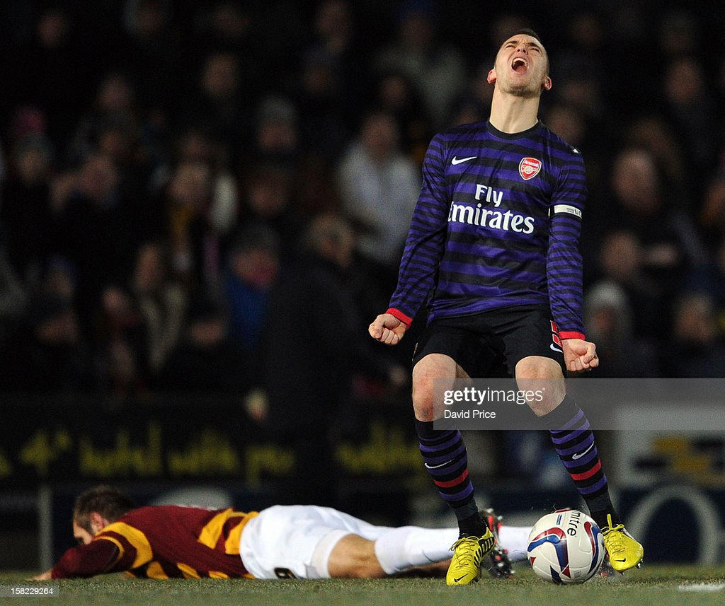 Thomas Vermaelen of Arsenal shows his anguish at being called for a foul against James Hanson of Bradford during the Capital One Cup match between Arsenal and Bradford City at Coral Windows Stadium, Valley Parade on December 11, 2012 in Bradford, England.