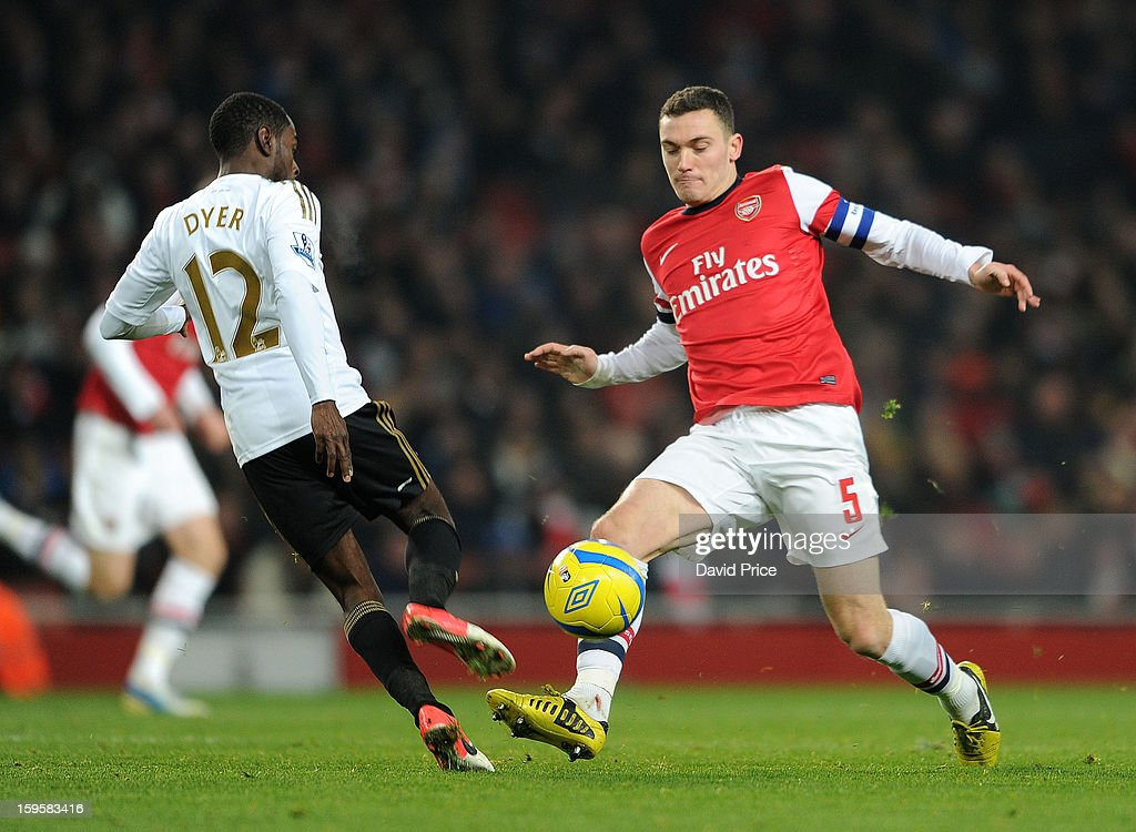 <a gi-track='captionPersonalityLinkClicked' href=/galleries/search?phrase=Thomas+Vermaelen&family=editorial&specificpeople=1360240 ng-click='$event.stopPropagation()'>Thomas Vermaelen</a> of Arsenal tackles Nathan Dyer of Swansea during the FA Cup Third Round Replay match between Arsenal and Swansea City at the Emirates Stadium on January 16, 2013 in London, England.