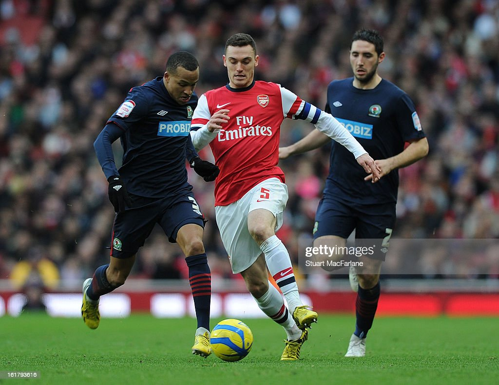 <a gi-track='captionPersonalityLinkClicked' href=/galleries/search?phrase=Thomas+Vermaelen&family=editorial&specificpeople=1360240 ng-click='$event.stopPropagation()'>Thomas Vermaelen</a> of Arsenal takes on <a gi-track='captionPersonalityLinkClicked' href=/galleries/search?phrase=Martin+Olsson&family=editorial&specificpeople=4185617 ng-click='$event.stopPropagation()'>Martin Olsson</a> (L) and Bradley Orr (R) of Blackburn during the FA Cup Fifth Round match between Arsenal and Blackburn Rovers at the Emirates Stadium on February 16, 2013 in London, England.