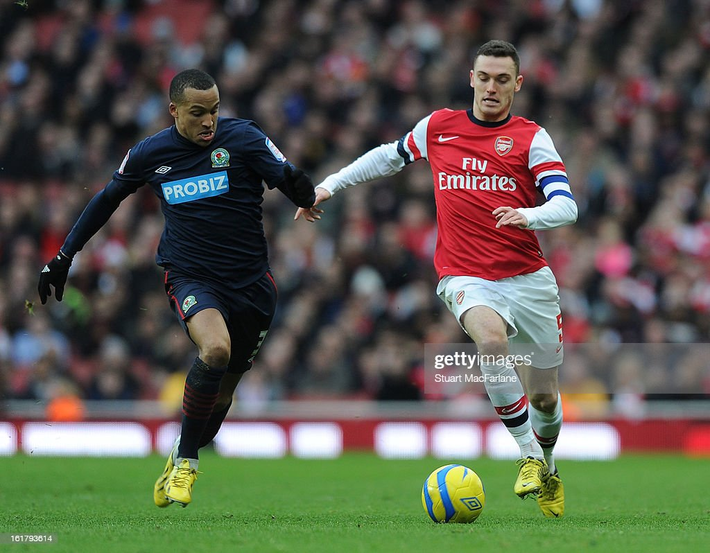 Thomas Vermaelen of Arsenal takes on Martin Olsson of Blackburn during the FA Cup Fifth Round match between Arsenal and Blackburn Rovers at the Emirates Stadium on February 16, 2013 in London, England.