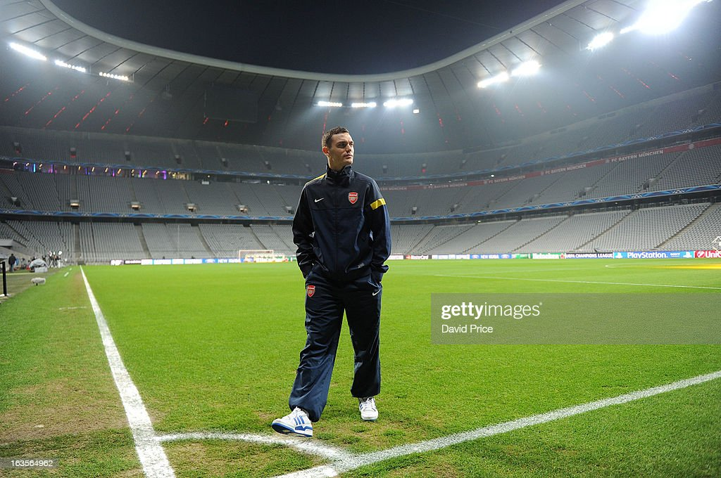 Thomas Vermaelen of Arsenal views the stadium before the Press Conference ahead of their UEFA Champions League Round of 16 match against Bayern Munich at Allianz Arena on March 12, 2013 in Munich, Germany.