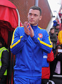 Thomas Vermaelen of Arsenal walks out to warm up prior to the Barclays Pemier League match between Stoke City and Arsenal at the Britannia Stadium on...