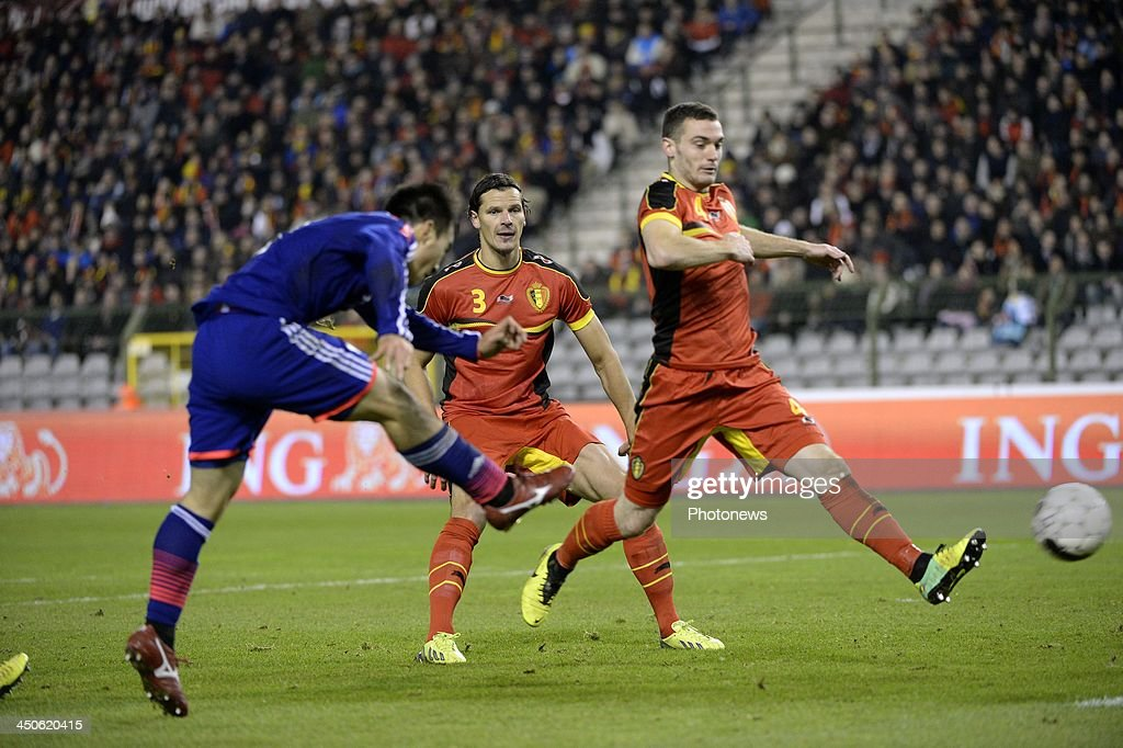 Thomas Vermaelen of Belgium and Okazaki of Japan scoring pictured during the international friendly match before the World Cup in Brasil between Belgium and Japan on November 19, 2013 in Brussels, Belgium