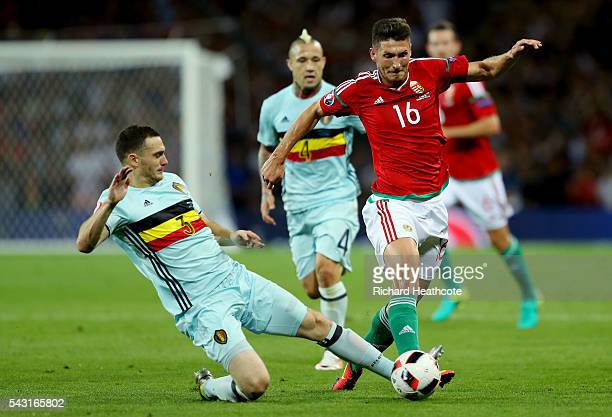 Thomas Vermaelen of Belgium slides in to tackle Adam Pinter of Hungary during the UEFA EURO 2016 round of 16 match between Hungary and Belgium at...