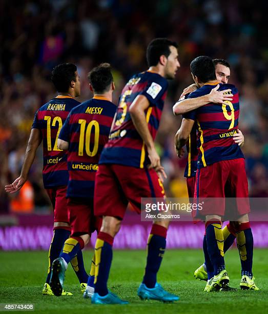 Thomas Vermaelen of FC Barcelona is congratulated by his temmate Luis Suarez after scoring the opening goal during the La Liga match between FC...