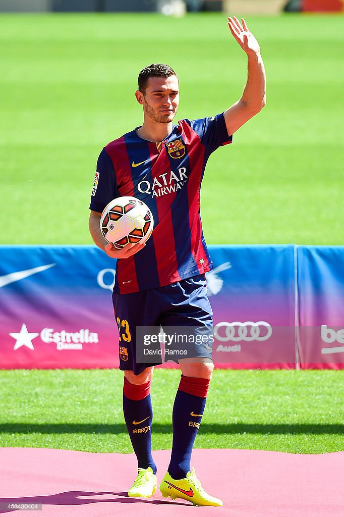 <a gi-track='captionPersonalityLinkClicked' href=/galleries/search?phrase=Thomas+Vermaelen&family=editorial&specificpeople=1360240 ng-click='$event.stopPropagation()'>Thomas Vermaelen</a> poses as he is unveiled as a new player for FC Barcelona at the Camp Nou stadium on August 10, 2014 in Barcelona, Spain.