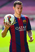 Thomas Vermaelen poses as he is unveiled as a new player for FC Barcelona at the Camp Nou stadium on August 10 2014 in Barcelona Spain