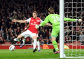 Thomas Vermaelen scores Arsenal's 2nd goal past Tim Krul of Newcastle during the Barclays Premier League match between Arsenal and Newcastle United...