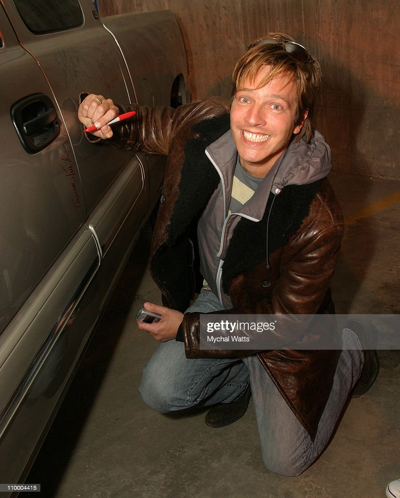 Thomas Vinterberg autographs a 2005 Chevrolet Silverado Pickup which General Motors will donate to the National Ability Center a local charity...