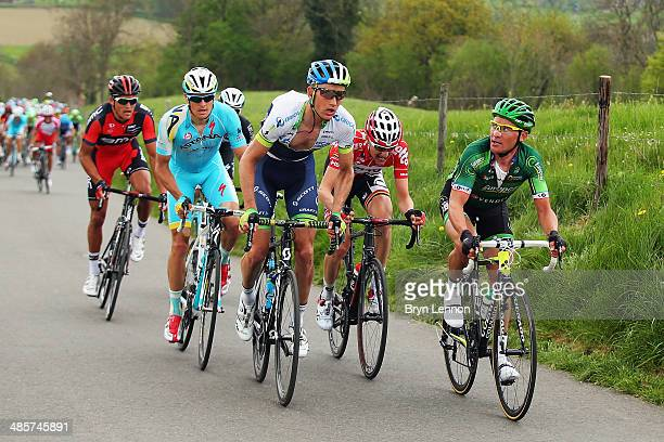 Thomas Voeckler of France and Europcar Team looks across at Pieter Weening of the Netherlands and Orica Greenedge during the 49th edition of the...