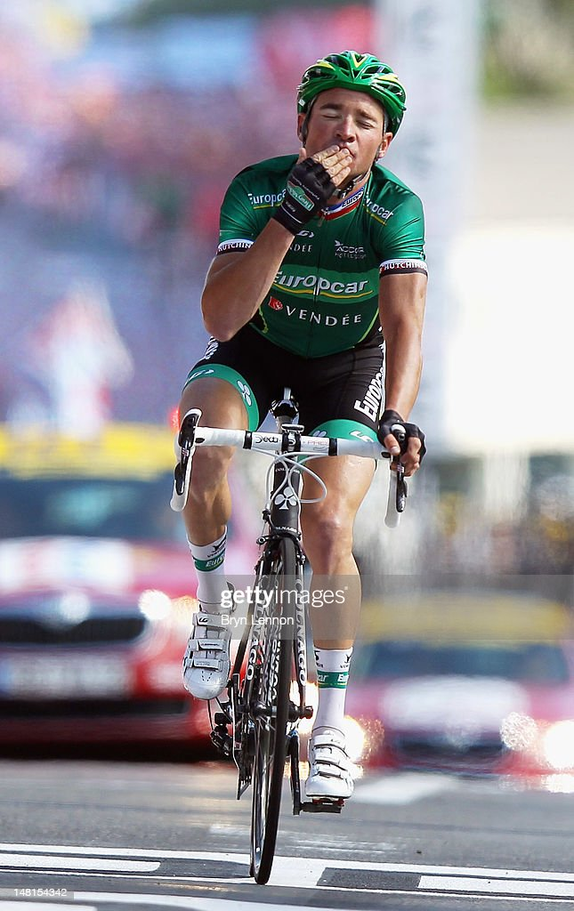 Thomas Voeckler of France and Team Europcar celebrates as he crosses the finish line to win stage ten of the 2012 Tour de France from Macon to...