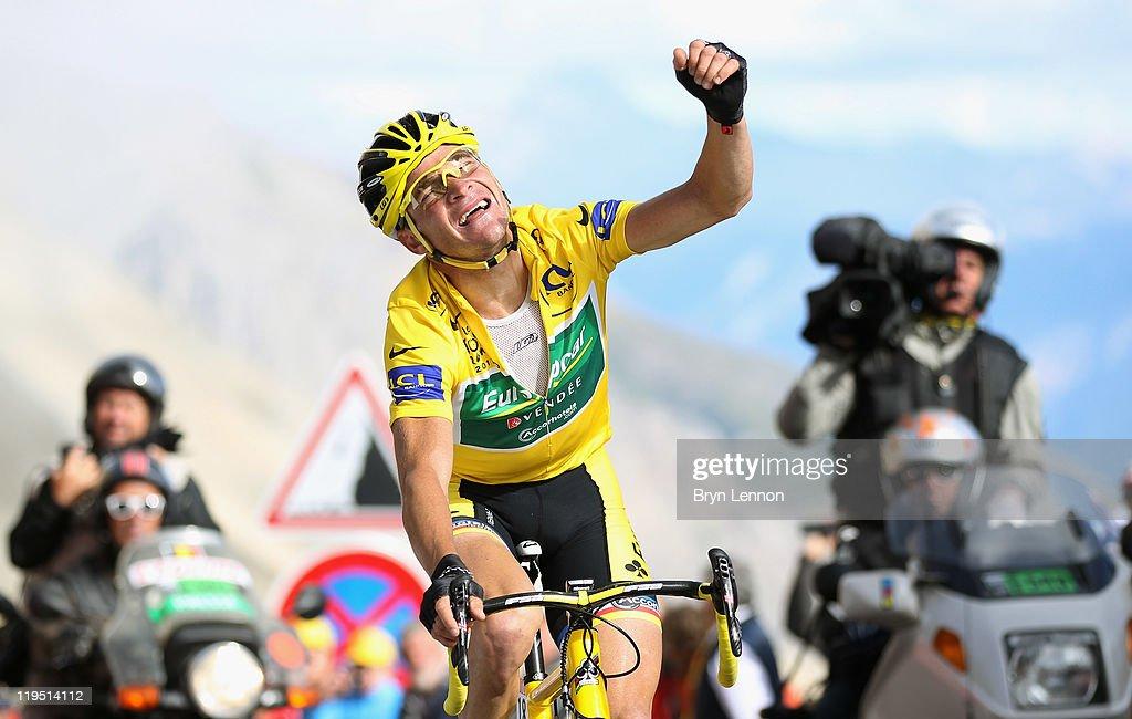 Thomas Voeckler of France and Team Europcar celebrates as he retains the race leaders' yellow jersey by 15 seconds after stage eighteen of the 2011...