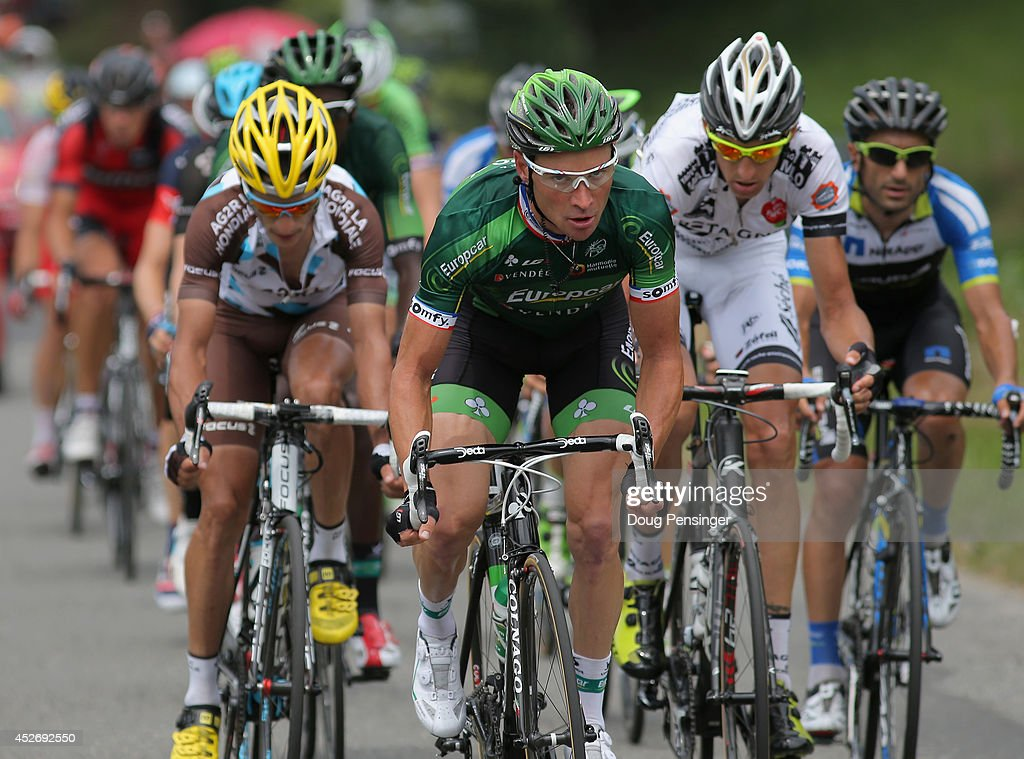 Thomas Voeckler (C) of France and Team Europcar leads the breakaway on the Cote de Loucrup during the eighteenth stage of the 2014 Tour de France, a 146km stage between Pau and Hautacam, on July 24, 2014 in Loucrup, France.