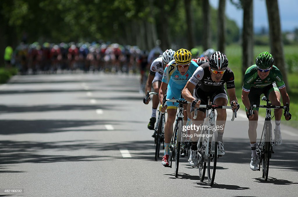 <a gi-track='captionPersonalityLinkClicked' href=/galleries/search?phrase=Thomas+Voeckler&family=editorial&specificpeople=212948 ng-click='$event.stopPropagation()'>Thomas Voeckler</a> of France and Team Europcar, Markel Irizar of Spain and Trek Factory Racing and <a gi-track='captionPersonalityLinkClicked' href=/galleries/search?phrase=Lieuwe+Westra&family=editorial&specificpeople=7552180 ng-click='$event.stopPropagation()'>Lieuwe Westra</a> of The Netherlands and the Astana Pro Team make the early move for the breakaway during stage ten of the 2014 Le Tour de France from Mulhouse to La Planche des Belles Filles on July 14, 2014 in Mulhouse, France.