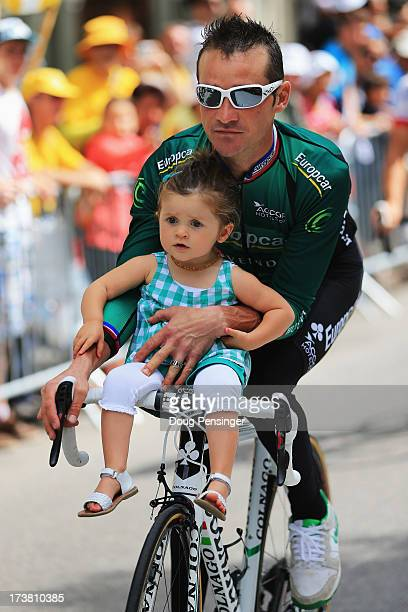 Thomas Voeckler of France and Team Europcar rides with his daughter Lila before stage eighteen of the 2013 Tour de France a 1725KM road stage from...