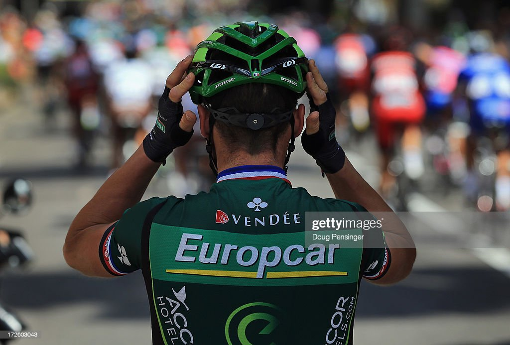 Thomas Voeckler of France riding for Team Europcar adjusts his helmet as he prepares for the start of stage five of the 2013 Tour de France, a 228.5KM road stage from Cagnes-sur-mer to Marseille, on July 3, 2013 in Cagnes-sur-Mer, France.