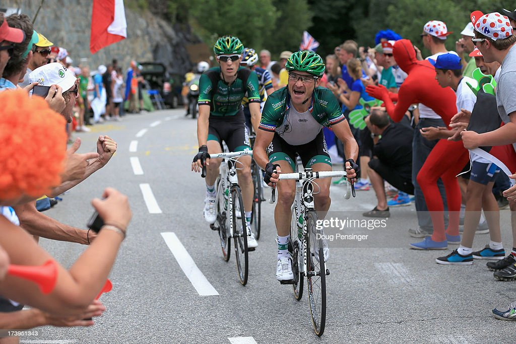 Thomas Voeckler of France riding for Team Europcar attacks the group of the yellow jersey and is followed by teammate Pierre Rolland of France riding...