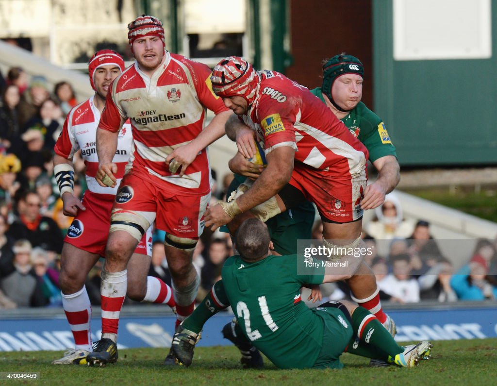 <a gi-track='captionPersonalityLinkClicked' href=/galleries/search?phrase=Thomas+Waldrom&family=editorial&specificpeople=561813 ng-click='$event.stopPropagation()'>Thomas Waldrom</a> and David Mele of Leicester Tigers tackle Sione Kalamafoni of Gloucester during the Aviva Premiership match between Leicester Tigers and Gloucester at Welford Road on February 16, 2014 in Leicester, England.