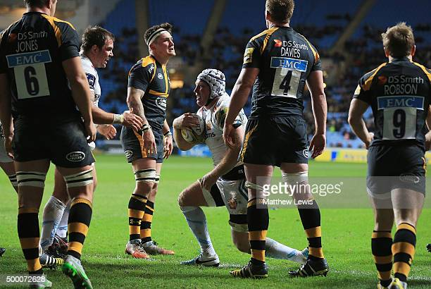 Thomas Waldrom of Exeter Chiefs celebrates his second try during the Aviva Premiership match between Wasps and Exeter Chiefs at the Ricoh Arena on...