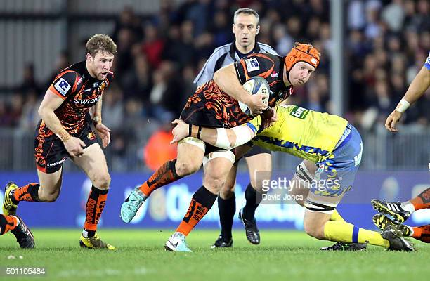 Thomas Waldrom of Exeter Chiefs runs at the Clermont Auvergne defence during the European Rugby Champions Cup match between Exeter Chiefs and...