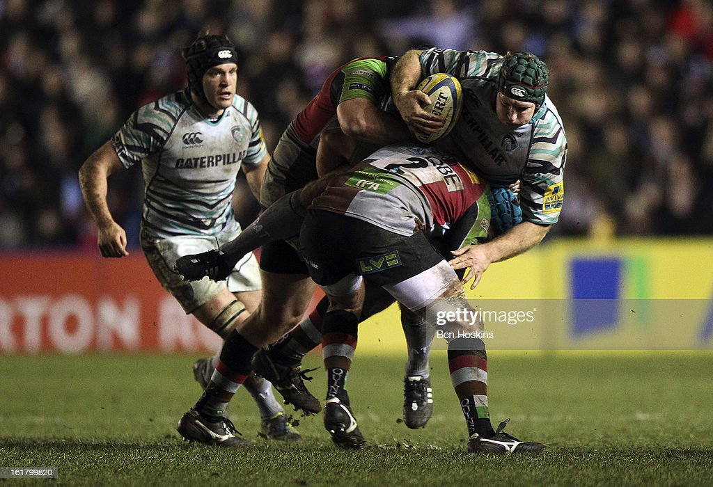 Thomas Waldrom of Leicester is tackled by Mark Lambert (L) and Joe Gray (R) of Harlequins during the Aviva Premiership match between Harlequins and Leicester Tigers at the Twickenham Stoop on February 16, 2013 in London, England.