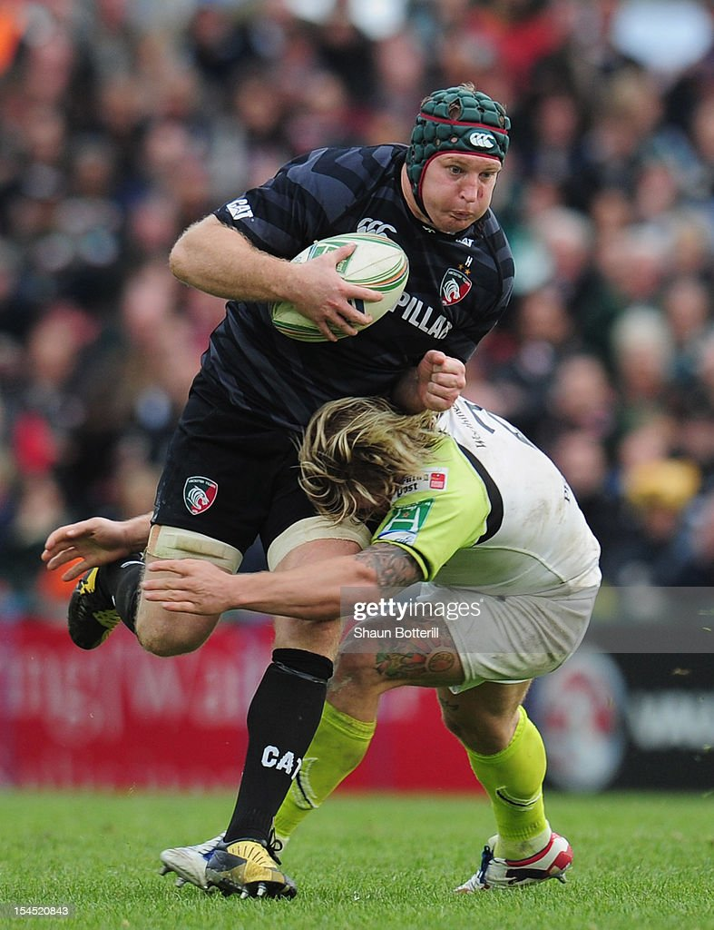 <a gi-track='captionPersonalityLinkClicked' href=/galleries/search?phrase=Thomas+Waldrom&family=editorial&specificpeople=561813 ng-click='$event.stopPropagation()'>Thomas Waldrom</a> of Leicester Tigers is tackled by of Richard Hibbard of Ospreys during the Heineken Cup Round 2 match between Leicester Tigers and Ospreys at Welford Road on October 21, 2012 in Leicester, England.