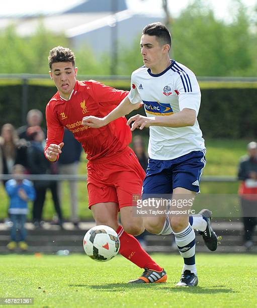 Thomas Walker of Bolton Wanderers and Adam Phillips of Liverpool in action during the Barclays Premier League Under 18 fixture between Liverpool and...
