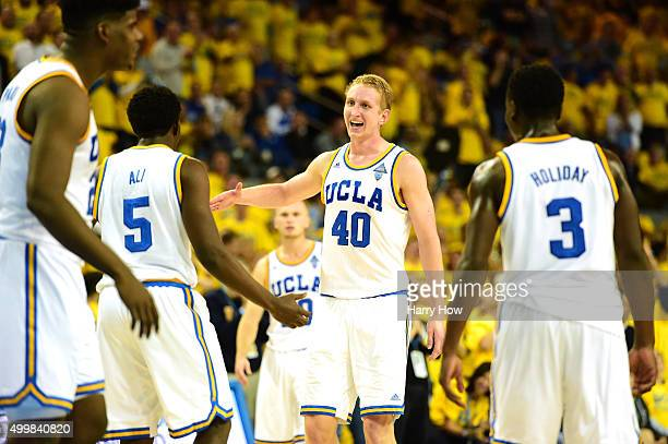 Thomas Welsh of the UCLA Bruins celebrates a dunk by Prince Ali during a 8777 win over the Kentucky Wildcats at Pauley Pavilion on December 3 2015 in...