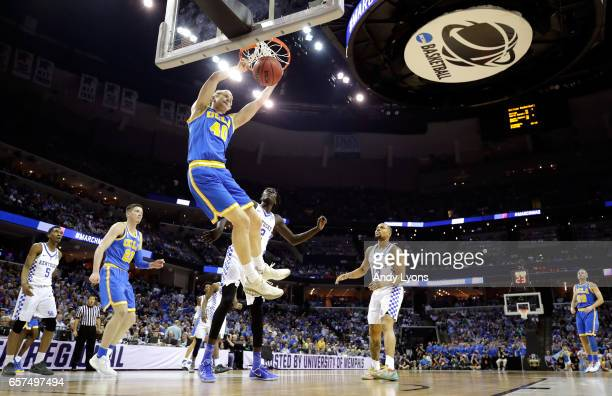 Thomas Welsh of the UCLA Bruins dunks in the first half against the Kentucky Wildcats during the 2017 NCAA Men's Basketball Tournament South Regional...