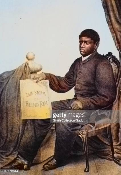 Thomas Wiggins the musical prodigy known as Blind Tom sitting in a chair and holding a sign that reads Rain Storm by Blind Tom 1879 From the New York...