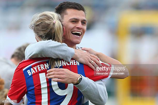 Thomas Woerle head coach of FC Bayern Muenchen celebrates winning the Allianz FrauenBundesliga Championhip titel with Carina Werner after the Allianz...