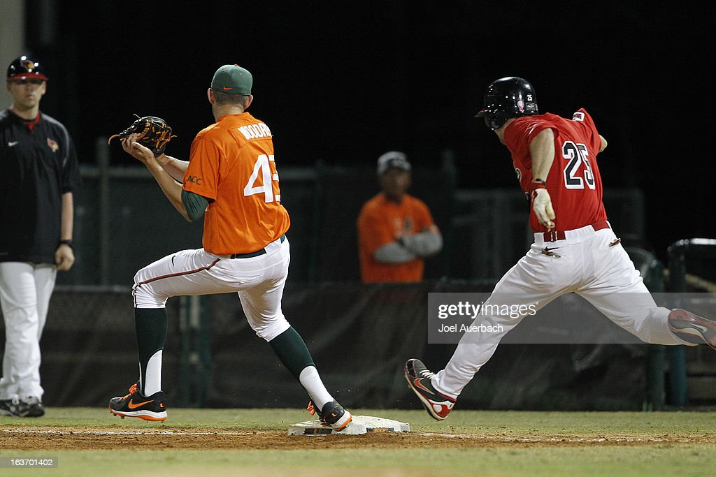 Thomas Woodrey #43 of the Miami Hurricanes beats Jack Czeszewski #25 of the Illinois State Redbirds to first base for the out in the seventh inning on March 13, 2013 at Alex Rodriguez Park at Mark Light Field in Coral Gables, Florida. The Hurricanes defeated the Redbirds 9-2.