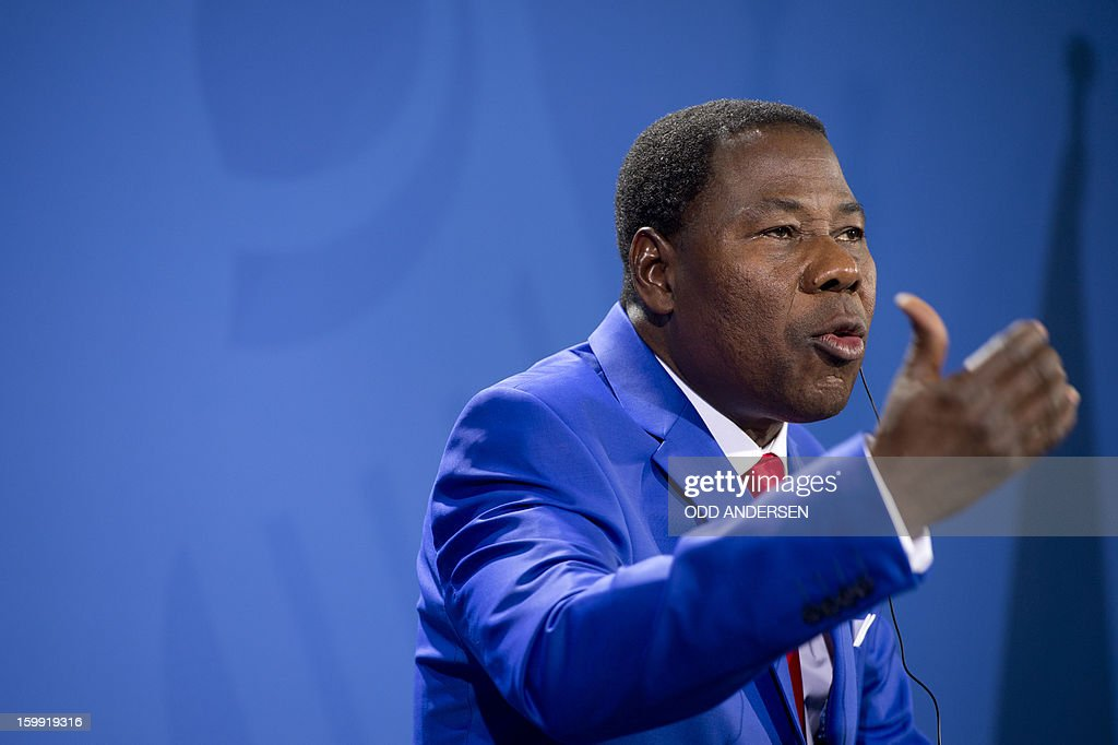 Thomas Yayi Boni , President of Benin gestures as he speaks during a joint press conference with German Chancellor Angela Merkel (not in pic) after their meeting at the Chancellery in Berlin to discuss the situation in Mali on January 23, 2013.Boni praised the 'remarkable work' of the French military in Mali, saying its troops were 'practically saving' Africa.