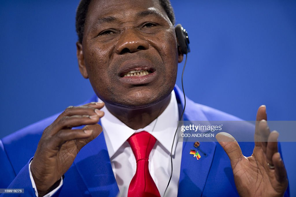 Thomas Yayi Boni , President of Benin reacts during a joint press conference with German Chancellor Angela Merkel after their meeting at the Chancellery in Berlin to discuss the situation in Mali on January 23, 2013.Boni praised the 'remarkable work' of the French military in Mali, saying its troops were 'practically saving' Africa.AFP PHOTO / ODD ANDERSEN