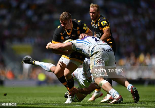 Thomas Young of Wasps is tackled by Luke CowanDickie of Exeter Chiefs during the Aviva Premiership Final between Wasps and Exeter Chiefs at...