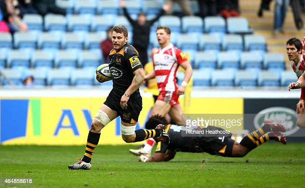 Thomas Young of Wasps runs in to score his second try during the Aviva Premiership match between Wasps and Gloucester at The Ricoh Arena on March 1...
