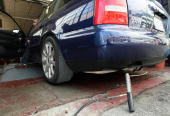 Thomas Zielin monitors a probe that was inserted into the tailpipe of a car while performing an emissions test at Smog Queen May 18 2009 in San...