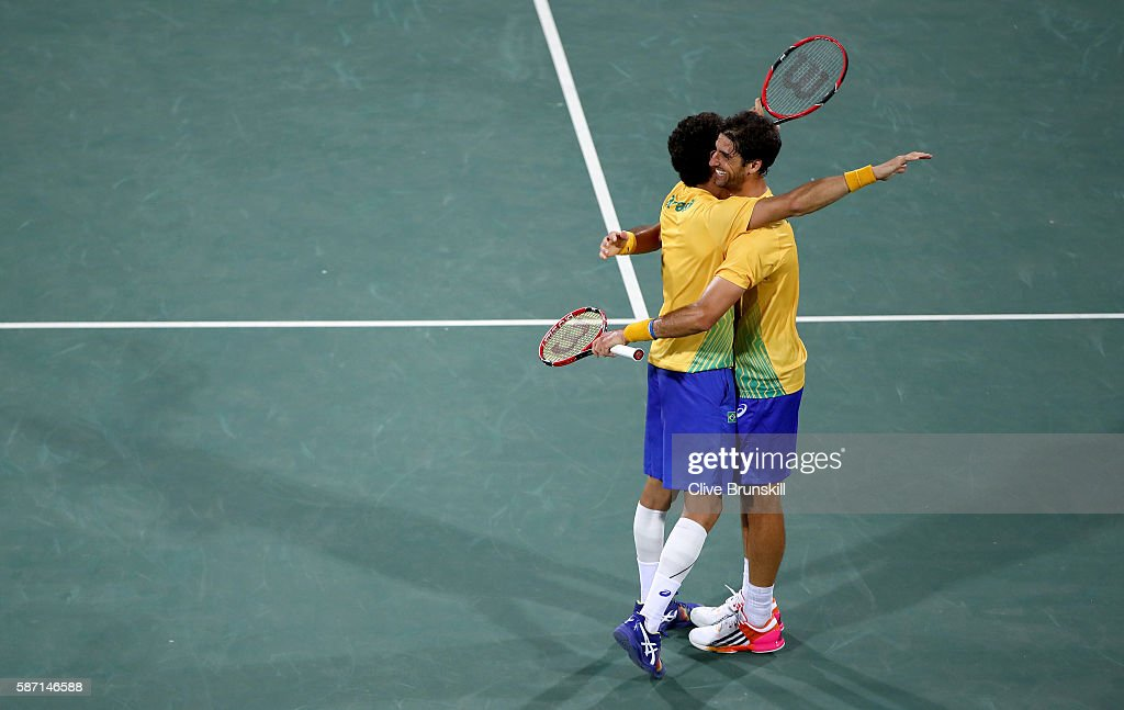 Thomaz Bellucci and Andre Sa of Brazil celebrate victory against Andy Murray and Jamie Murray of Great Britain in the mens doubles on Day 2 of the Rio 2016 Olympic Games at the Olympic Tennis Centre on August 7, 2016 in Rio de Janeiro, Brazil.
