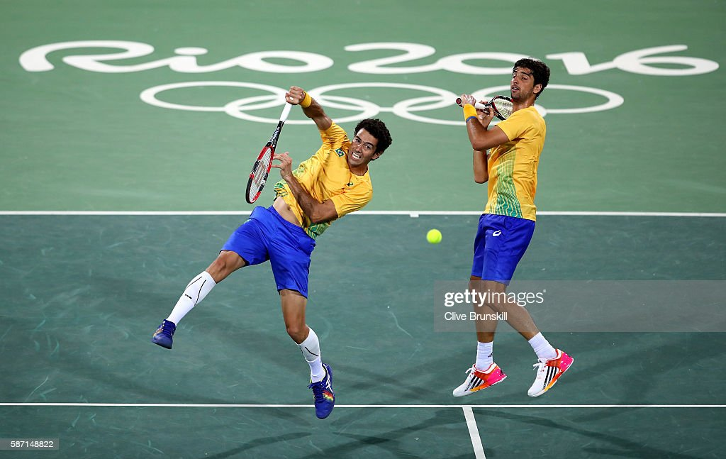 Thomaz Bellucci and Andre Sa of Brazil in action against Andy Murray and Jamie Murray of Great Britain in the mens doubles on Day 2 of the Rio 2016 Olympic Games at the Olympic Tennis Centre on August 7, 2016 in Rio de Janeiro, Brazil.