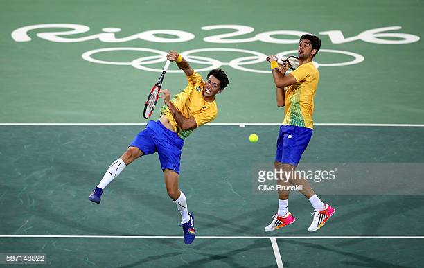Thomaz Bellucci and Andre Sa of Brazil in action against Andy Murray and Jamie Murray of Great Britain in the mens doubles on Day 2 of the Rio 2016...