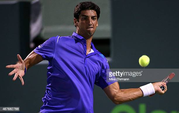 Thomaz Bellucci of Brasil plays a match against Lleyton Hewitt of Australia during Day 4 of the Miami Open presented by Itau at Crandon Park Tennis...