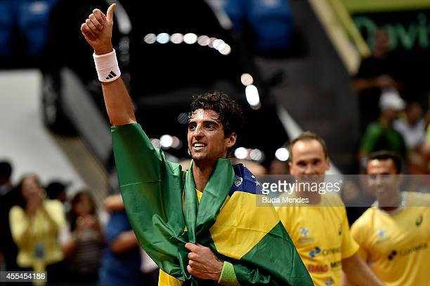 Thomaz Bellucci of Brazil acknowledges the fans after winning his playoff singles match against Roberto Bautista Agut of Spain on the World Group...