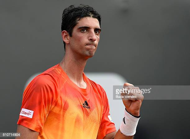 Thomaz Bellucci of Brazil celebrates a point against Alexandr Dolgopolov of Ukraine during the Rio Open Day 2 at Jockey Club Brasileiro on February...