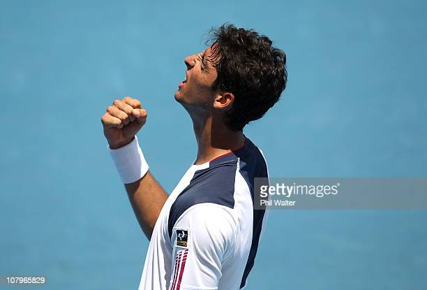 Thomaz Bellucci of Brazil celebrates winning his match against Michael Russell of the USA on day two of the Heineken Open at ASB Tennis Centre on...
