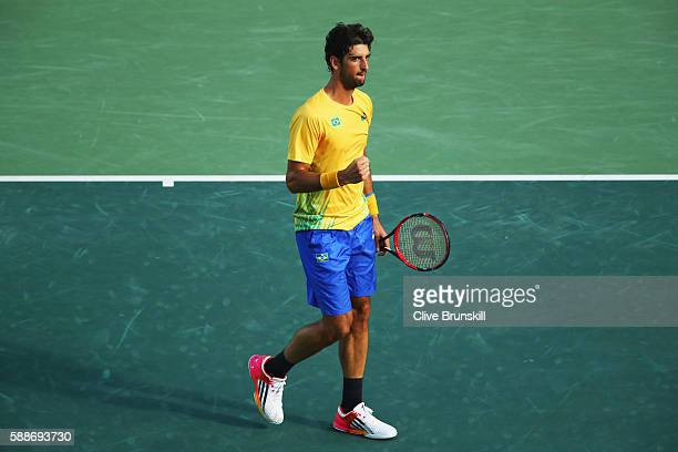 Thomaz Bellucci of Brazil celebrates winning the first set 62 against Rafael Nadal of Spain in the Men's Singles Quarterfinal on Day 7 of the Rio...