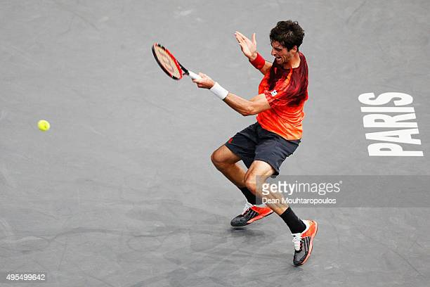 Thomaz Bellucci of Brazil in action against Novak Djokovic of Serbia during Day 2 of the BNP Paribas Masters held at AccorHotels Arena on November 3...